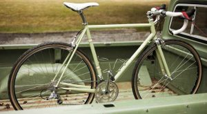 Green custom bike built by Hampsten Cycles featuring a painted carbon fork from Wound Up Composite Cycles