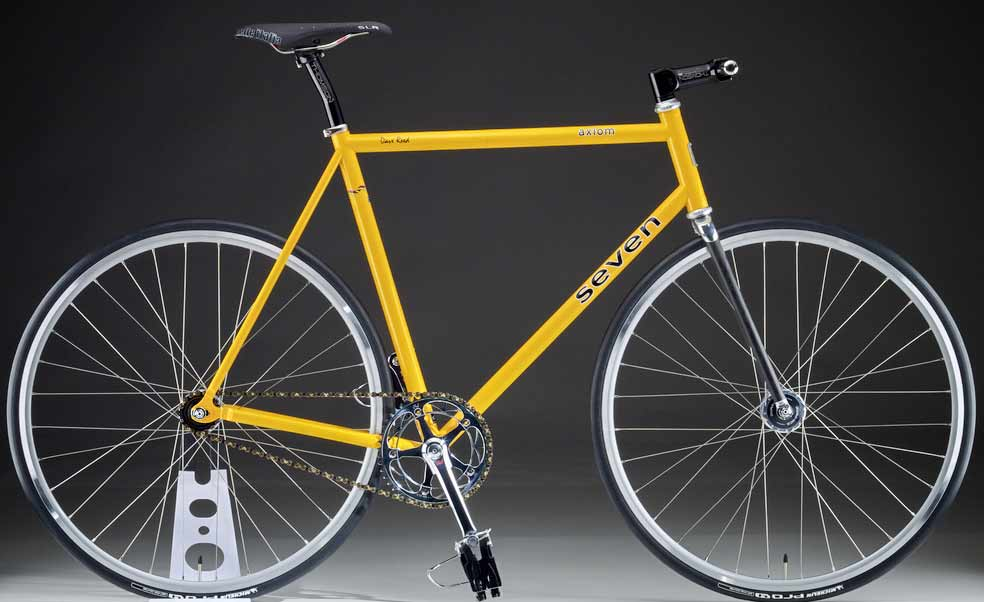 Ra Sun God yellow Seven fixed gear track bike from Taylor Hurley of Mobius Cycle features the carbon fiber Zephyr fixie fork made in the USA by Wound Up Composite Cycles