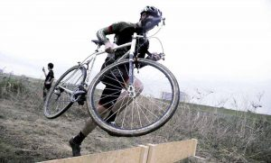 Simworks-cyclocross-racer-carries-CX-bike-over-obstacles-and-through-muck-with-Wound-Up-Team-X-carbon-fork