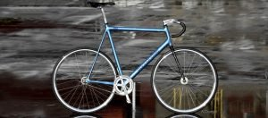 Amy Danger custom blue Cannondale fixie bike with carbon fiber Zephyr track fork made in Salt Lake City Utah USA by Wound Up Composite Cycles