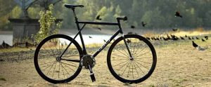 Amy Dangers black GT fixie with carbon fiber Wound Up Composite Cycles carbon fiber Zephyr track fork